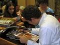 David signing pictures - over the shoulder shot